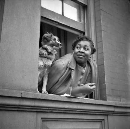 Gordon Parks - A woman and her dog in the Harlem section, 1943